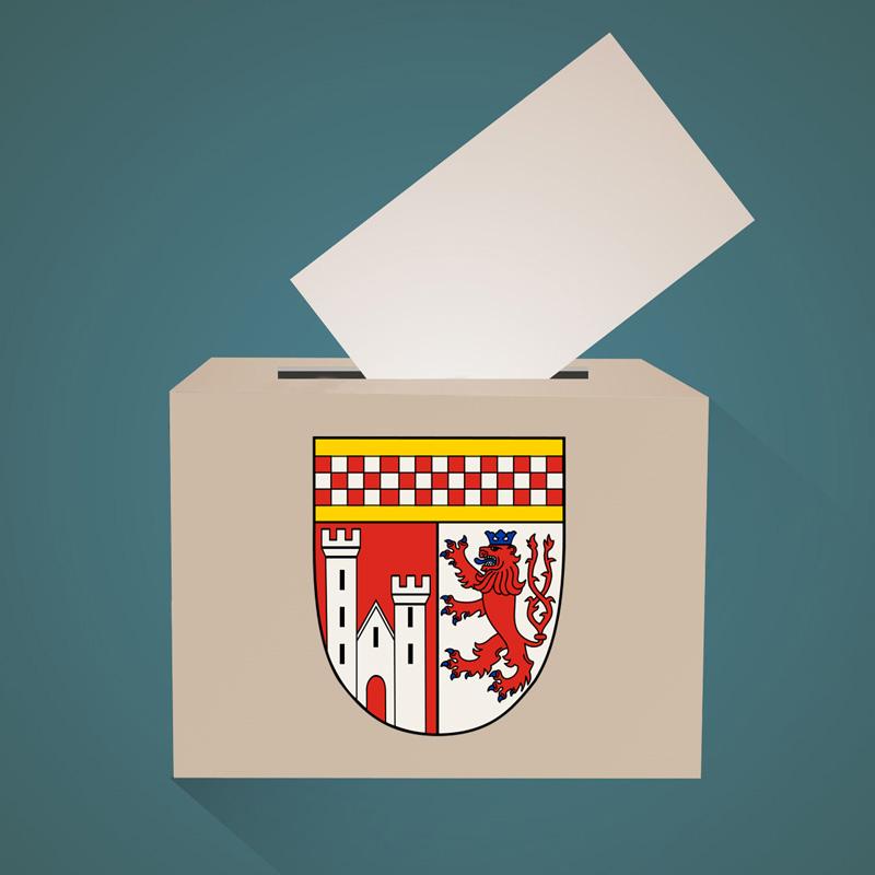 Symbolbild Wahlurne mit Wappen des Oberbergischen Kreises